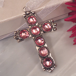 Shimmering silver cross with pink crystals