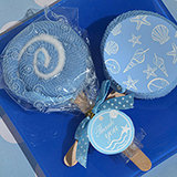 Lollipop towel favor blue Seashells design