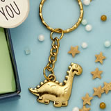 Adorable Gold dinosaur key chain from fashioncraft