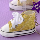 Authentic canvas mini sneaker in the classic hi-top shape with a sparkle gold glitter design
