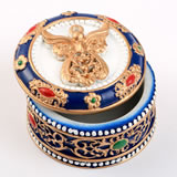angel covered box with ornate with gold accents