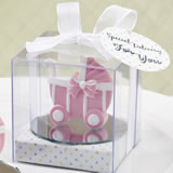 Pink baby carriage / stroller design favor with a round glass mirror bottom base