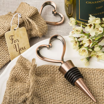 Vintage heart shaped all metal bottle stopper in an antique copper plated finish