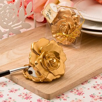 Ornate matte gold rose design compact mirror from fashioncraft.