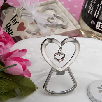 Heart shaped silver metal bottle opener with dangling heart design