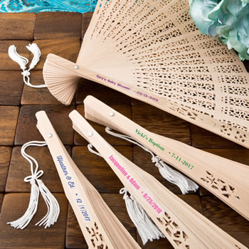 Intricately carved personalized Sandalwood fan favors from fashioncraft with box