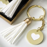 Gold metal heart themed white tassel key chain