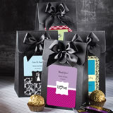 "Black ""Delivered with Love"" boxes from the <em>Personalized Expressions Collection</em>"